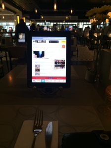 Ordering dinner off an iPad at Mimosa in MSP Terminal G. (Katherine Hart, 2014)